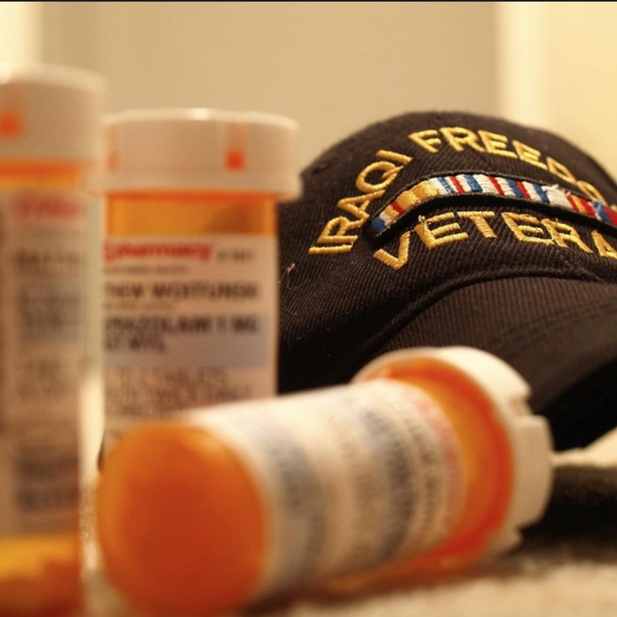 Iraq veteran baseball hat with prescription medicine bottles stock image from Wikimedia Commons