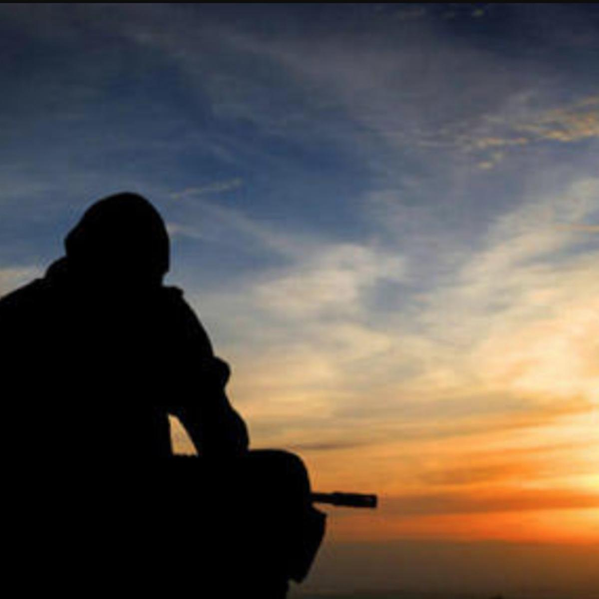 Silhouette of soldier watching sunset photo courtesy military.com